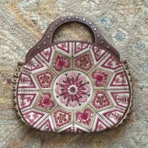 Embroidered circular handbag